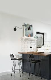 kitchen of the week a shaker inspired kitchen in east dulwich above the iroko topped island extends out as a breakfast counter the subway tiles were sourced from tons of tiles in the uk and are in an offset brick