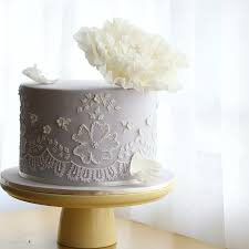wedding cake vendors pretty wedding cake with white lace detail and sugar peony top