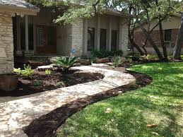 oklahoma flagstone walkway entry with accent moss rock and native