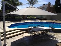 swimming pool table set with umbrella exterior design exciting cantilever patio umbrella for inspiring