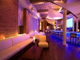 adorable puple interior lighting with white luxury sofas on the