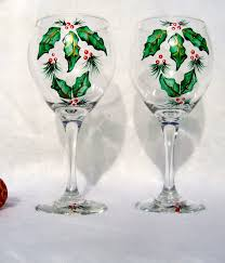 wine glass painting christmas painted wine glasses with holly on luulla