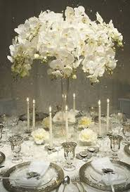 white centerpieces white and hydrangea centerpiece in a silver lined vase