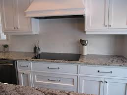grey glass subway tile backsplash in classic white kitchen found