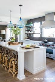 blue recycled glass light pendants over white island