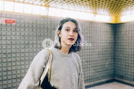 looking with grey hair young beautiful caucasian purple grey hair woman in the subway