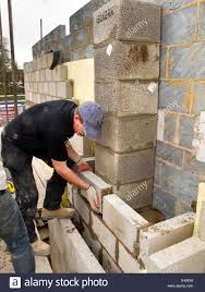 Building A Cinder Block House Self Building House Bricklayers Laying Concrete Block Around