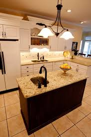 granite top on brown wooden kitchen island with chrome metal