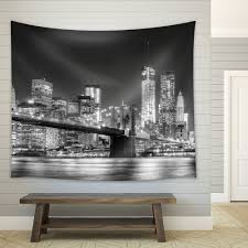 wall26 com art prints framed art canvas prints greeting wall26 grayscale photograph of the brooklyn bridge looking over new york city at night time fabric tapestry home decor 88x104 inches