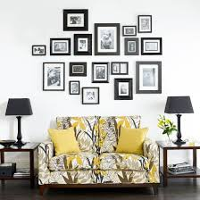 Design A Sofa Create A Family Photo Wall That Will Grow Over Time As Your Family