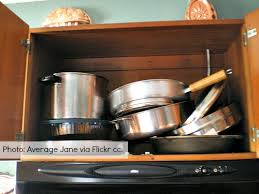 how to organize pots and pans in a cupboard 3 solutions to organize pots and pans moving insider
