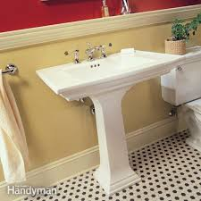 install cabinets like a pro the family handyman how to plumb a pedestal sink the family handyman bathroom sink