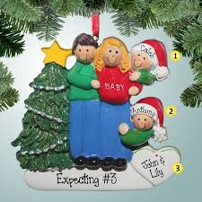 1st christmas ornaments expecting family in blue jeans 3rd kid