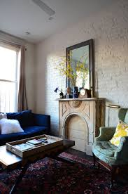 my home design nyc new york studio apartment with exposed brick and fireplace