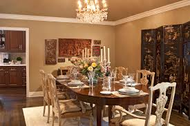warm neutral paint dining room traditional with chandelier semi