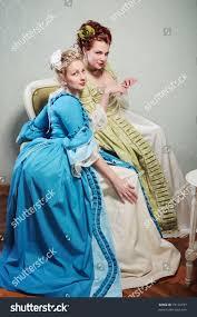 two beautiful ladies lavish historical dresses stock photo