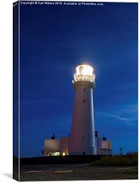 light house at night flamborough lighthouse at night canvas print by karl wilson