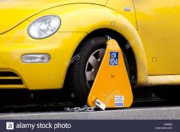 yellow volkswagen beetle royalty free vw beetle car with a wheel clamp for false parking in dublin stock