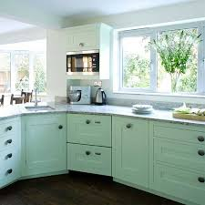 how to paint kitchen cabinets melamine home dzine kitchen plain white melamine kitchen goes coastal
