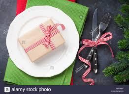 gift box dinner plate silverware fir tree top view