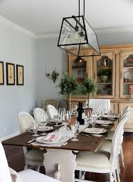 farmhouse style dining table and chairs with white armless chairs