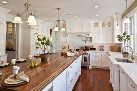 white kitchen wood island a new house with turn of the century style by buck custom homes