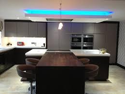 led under cabinet strip lighting kitchen comfortable light on backsplash also wood countertops
