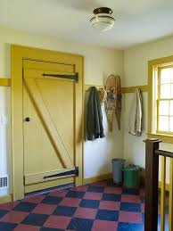 yellow front door entry farmhouse with barn style traditional