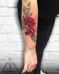 what does flower tattoos really mean colorful flowers tattoo on a u0027s shoulder and upper arm