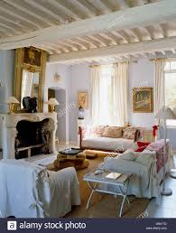white loose covers on armchair and sofas in french country living