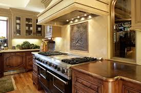 copper backsplash kitchen mediterranean with cove lighting glass