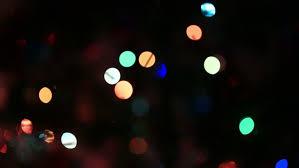 defocused colorful sparkling christmas lights for festive