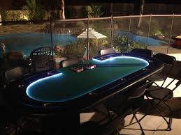 deluxe led gaming table overlooking beautiful backyard and pool