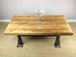 a butcher block dining table with a rustic downhome design