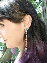 one earring how to rock the one earring trend try a glam oversized