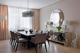 dining room dining room wall decor with round metal framed mirror dining room wall decor with round metal framed mirror and glossy cabinet underneath with two table lamps for beige modern dining room