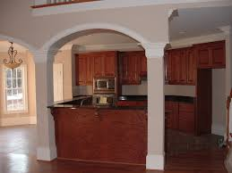 hand made custom oak top and bottom kitchen cabinets with a raised