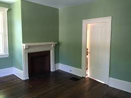 green paint colors living room traditional with fireplace mantels