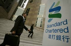 standard chartered reports first annual loss since 1989 wsj