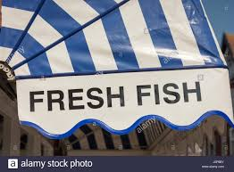 Sign Awning A Fresh Fish Shop Sign On A Blue And White Stripped Awning In