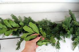 sprucing up a fake garland with real greenery the v spot