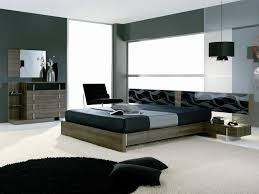 interior modern bottle green bedroom featuring olive wood