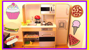 playing with a toy kitchen and play food kidkraft toy kitchen
