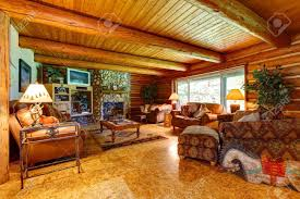 log cabin living room interior with wood ceiling stock photo