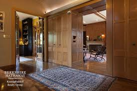 traditional hallway with wood paneling cove lighting zillow