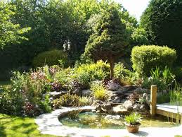 small garden pond with waterfall and deck landscape garden