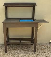 gardening bench potting bench turned outdoor bar
