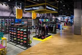 shop boots dubai sun sand sports store by green room dubai uae retail design