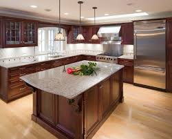 dark cabinets light floors kitchen modern with wall ovens