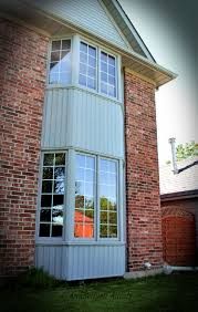 cream windows on red brick house ireland google search house wood clad aluminum bay windows gray aluminum cladding on the exterior stained pine inside